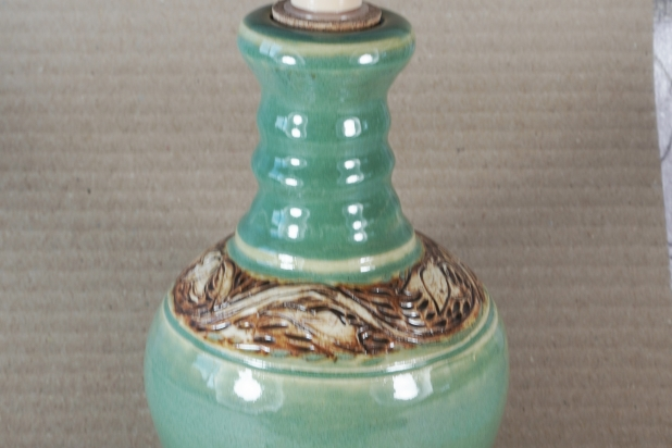 Green lotion bottle with floral pattern